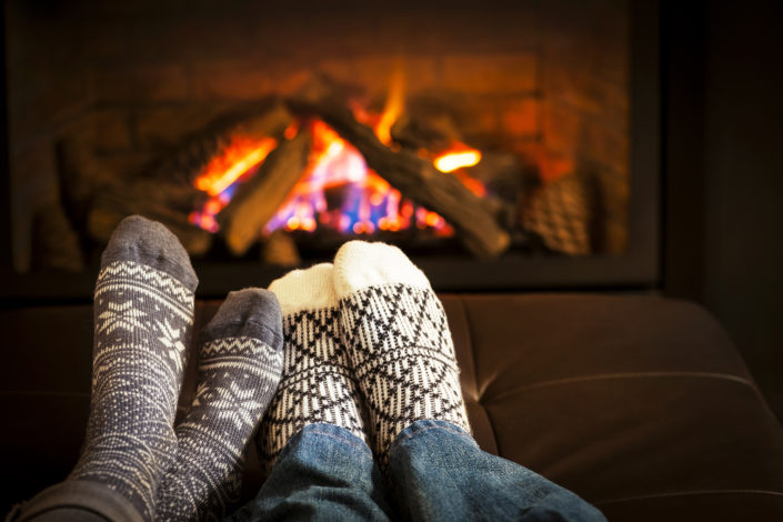 Working Ventures Insurance Feet warming by fireplace